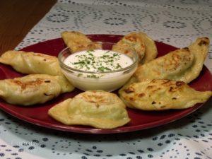eating-pierogi-with-sour-creme